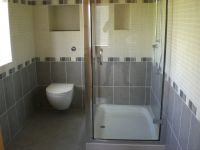 Double shower tray and glass enclosure with wall hung wc and consealed cistern with push flush