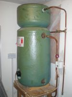 Combi cylinder and immersion heater