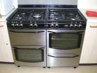 Double oven gas cooker with wok burner