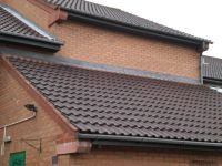 Cover flashing lead work with OG guttering at several levels