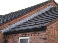 Step flashing and lead soakers with seamless guttering